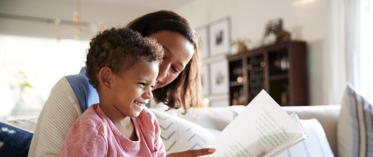 Mom reads book to child